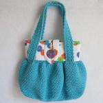düğmeli mavi örgü kol çantası modeli
