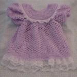 lila renkli tüllü örgü bebek bluzu modeli