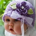 mor çiçekli kurdelalı bebek şapka modeli