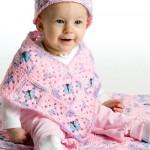 pembe kelebek motifli şapkalı bebek panço modeli