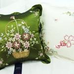 yeşil yastık sepet içinde gül kurdele nakışı işlemeli