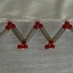 kırmızı boru boncuklu tülbent oyası örneği