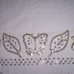 yaprak desenli gri pullu havlu kenarı örneği