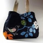 çiçek ve kuş desenli kumaş kol çantası modeli