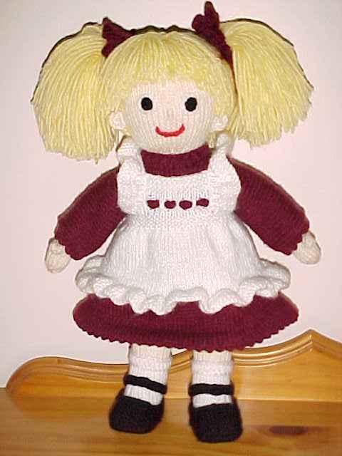 Oyuncaklar kırmızı beyaz elbiseli örgü oyuncak bebek modeli