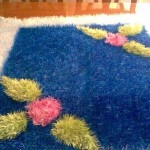 lacivert çiçek desenli sakallı ip halı örneği
