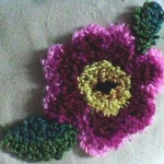 mor çiçekli punch nakışı modeli