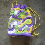 mor renkli desenli örgü çocuk sırt çantası modeli