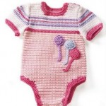 pembe tonlarında örülmüş örgü bebek tulumu modeli