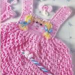 pembe askılı insan yüzü motifli kız bebek elbiseleri yeni